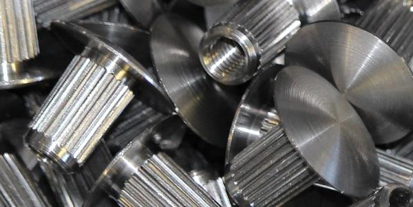 Ecrou décolleté moleté en acier
